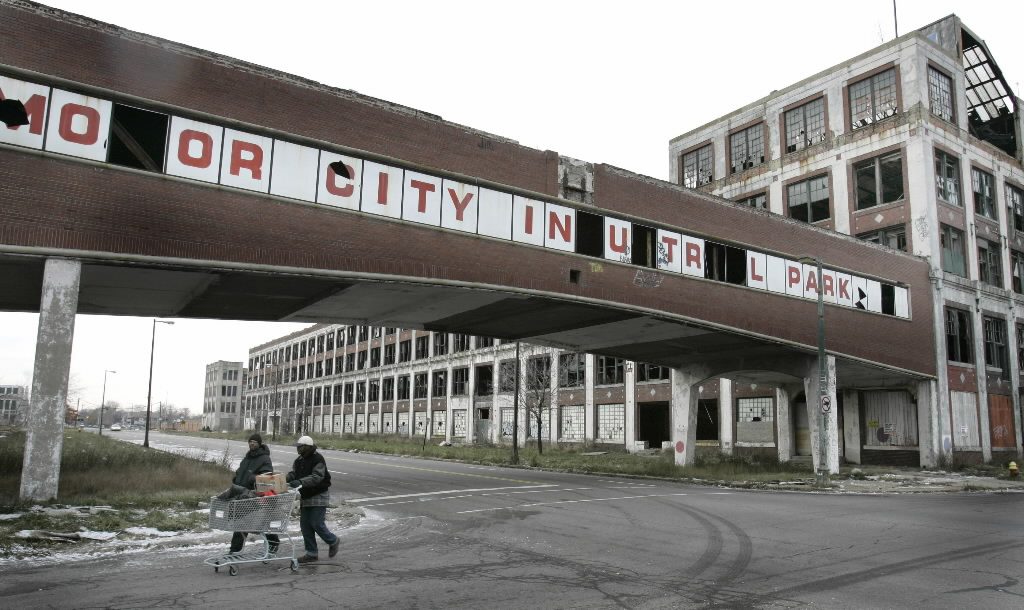 1120128 bytes; 3340 x 1992; Pedestrians walk by the abandoned Packard plant in east Detroit, Thursday, Dec. 11, 2008. The plant,