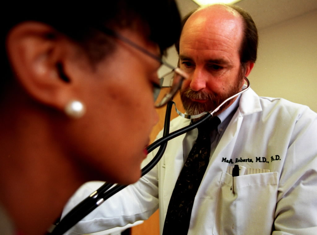507739 bytes; 2232 x 1656; Dr.Mark A. Roberts does an exam of Lyn K. Moore at Employee Health Services on Monday, July 14.
