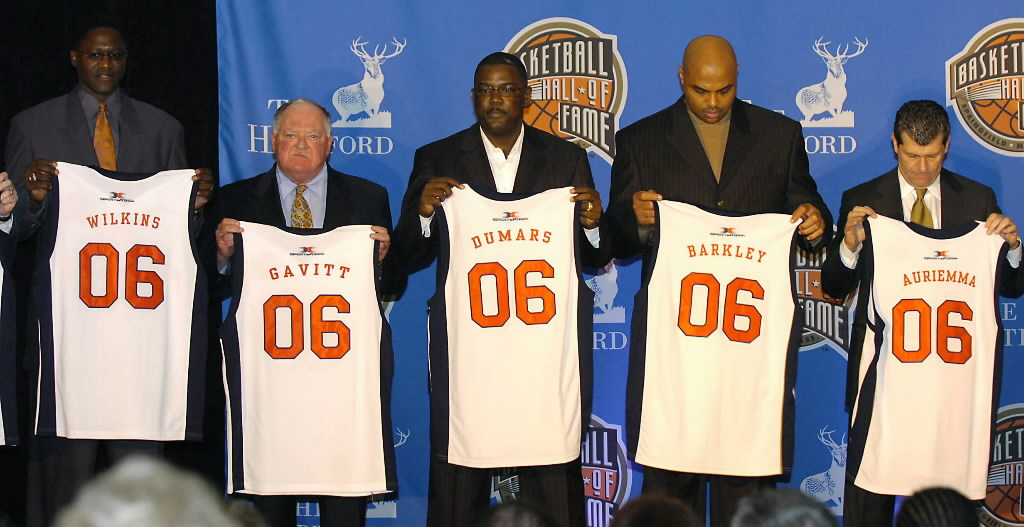 291539 bytes; 2464 x 1269; Former NBA star Dominique Wilkins, left, former NCAA Foundation president David Gavitt, second left,