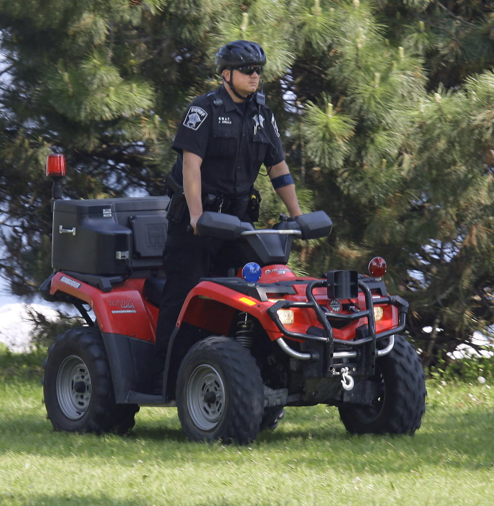 449435 bytes; 1875 x 1923; A member of the Milwaukee County  Sheriff's SWAT team patrols the lakefront and beach area on a vehi