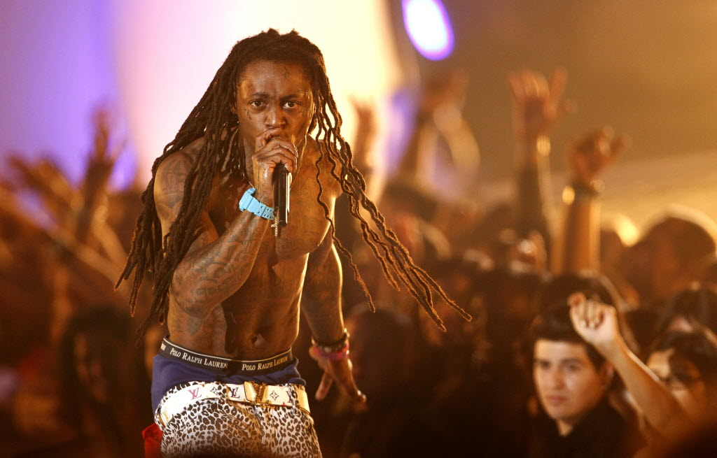 673363 bytes; 3000 x 1919; Lil Wayne performs at the MTV Video Music Awards on Sunday Aug. 28, 2011, in Los Angeles. (AP Photo/