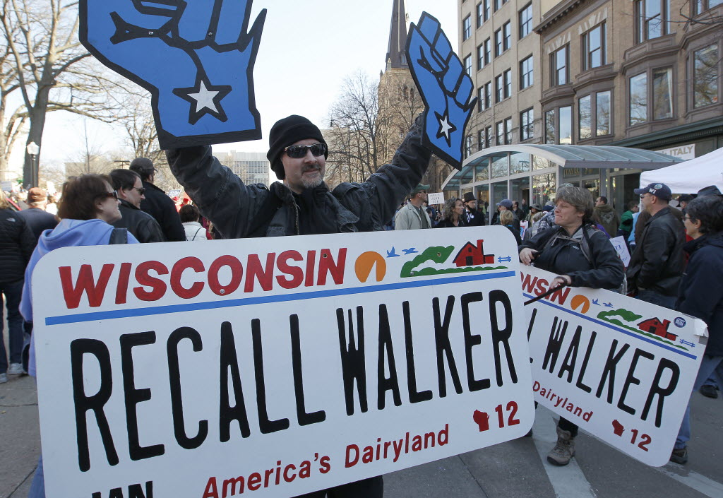 3760145 bytes; 4536 x 3126; LABOR11, NWS, PORTER, 6. - Paul Tennesen, of Madison, carries a recall Walker license plate during a