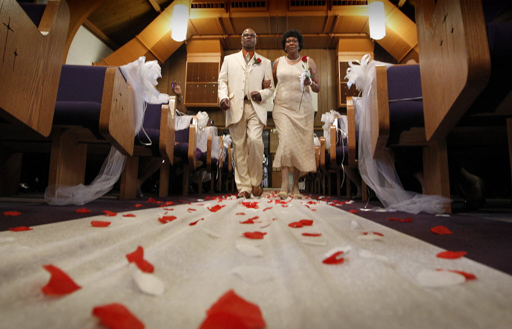 2741398 bytes; 3691 x 2372; MARRIAGE, NWS, PORTER, 8. - Couples walk down the aisle at New Hope Missionary Baptist Church during